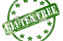 A green ink weathered roughed up circle and stars stamp design with the word GLUTEN FREE on it making a great concept.